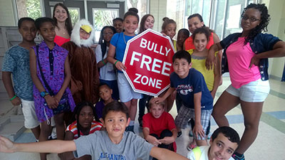 Bully free zone stop sign w kids-ACPS