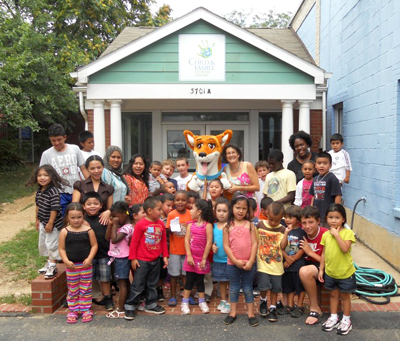 Children at the Child and Family Network Centers enjoy a visit from Jazz the DreamDog. (Courtesy Photo)