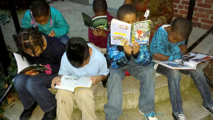 kids reading cropped-Alexandria Gazette