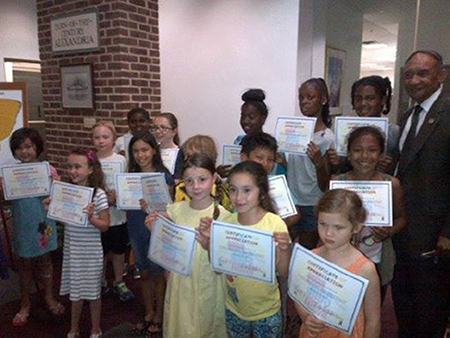 children holding certificates-Alexandria Gazette